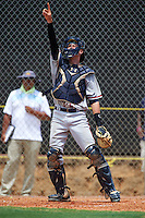 GCL Braves catcher Collin Yelich (62) points to a popup during a game against the GCL Astros on July 23, 2015 at the Osceola County Stadium Complex in Kissimmee, Florida.  GCL Braves defeated GCL Astros 4-2.  (Mike Janes/Four Seam Images)