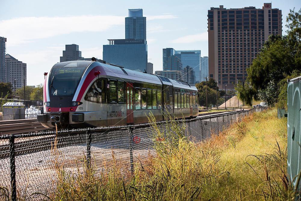 MetroRail train passes through downtown Austin headed to the Plaza Saltillo Capital Metro Rail commuter rail station East Austin.