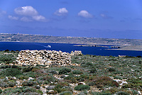 Marfa Ridge, Northwest Malta, Gozo and Comino islands in Distance.  Bird Hunter's Shelter, with Gozo-Malta Ferry in Background.  Thyme grows on the poor Limestone soil.