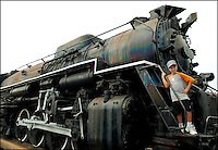 A boy stands aboard the front of a steam engine at the Baltimore & Ohio Railroad Museum (B&O Railroad Museum) in Baltimore, Md. Many consider the museum the birthplace of American railroading. The museum offers collections and exhibits throughout its 40-acre site to educate the public about the history of trains and railroads. Boy is model released.