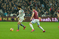 Mohamed Salah of Liverpool and Aaron Cresswell of West Ham United during West Ham United vs Liverpool, Premier League Football at The London Stadium on 4th February 2019