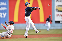 Asheville Tourists second baseman Forrest Wall (7) makes the turn on a double play over a hard sliding Nick Longhi (21) during game one of a double header against the Greenville Drive on April 18, 2015 in Asheville, North Carolina. The Tourists defeated the Drive 2-1. (Tony Farlow/Four Seam Images)