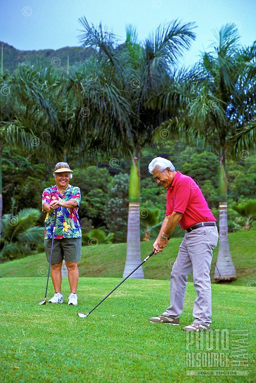 Senior Hawaiian man and part-Hawaiian woman at Pali Golf Course, Windward Oahu
