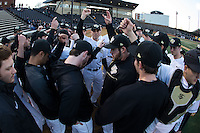 Wake Forest Demon Deacons head coach Tom Walter (16) gathers his team together prior to the start of the game against the Georgetown Hoyas at David F. Couch Ballpark on February 19, 2016 in Winston-Salem, North Carolina.  The Demon Deacons defeated the Hoyas 3-1.  (Brian Westerholt/Four Seam Images)