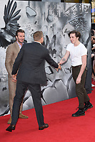 """Charlie Hunnam with David and Brooklyn Beckham<br /> at the premiere of """"King Arthur:Legend of the Sword"""" at the Empire Leicester Square, London. <br /> <br /> <br /> ©Ash Knotek  D3265  10/05/2017"""