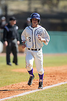 Hunter Lee (2) of the High Point Panthers jogs down the third base line as he scores a run against the LIU-Brooklyn Blackbirds at Willard Stadium on March 8, 2015 in High Point, North Carolina.  The Panthers defeated the Blackbirds 9-0.  (Brian Westerholt/Four Seam Images)