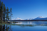 Crane Prairie Reservoir, boat on shore, with South Sister, Broken Top & Mount  Bachelor in the distance; Deschutes National Forest, Cascade Mountains, Oregon.