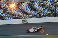 Sunset, Rolex 24 at Daytona, Daytona International Speedway, Daytona Beach, FL, January 2014.  (Photo by Brian Cleary/www.bcpix.com)