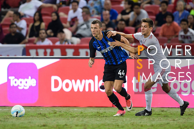FC Internazionale Forward Ivan Perisic (L) fights for the ball with Bayern Munich Forward Milos Pantovic (R) during the International Champions Cup match between FC Bayern and FC Internazionale at National Stadium on July 27, 2017 in Singapore. Photo by Weixiang Lim / Power Sport Images