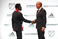 Philadelphia, PA - Thursday January 19, 2018: Ema Twumasi, Don Garber during the 2018 MLS SuperDraft at the Pennsylvania Convention Center.