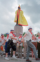 Saint Petersburg, Russia, June 2002..The suburban village of Pushkin hosts the annual Tsarskoe Selo Carnival, when city bureaucrats have their ties cut off and the statue of Lenin is dressed as a clown.
