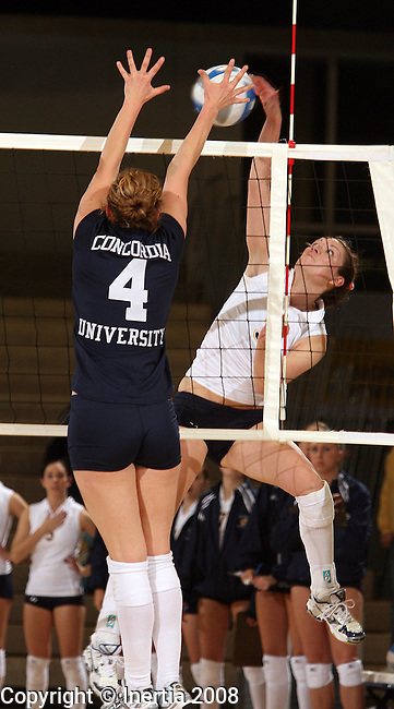 SIOUX FALLS, SD - OCTOBER 31:  Rebecca Hindman #3 of Augustana tries for a kill past Maggie McNamara #4 of Concordia St. Paul in the first game of their match Friday night at the Elmen Center.  (Photo by Dave Eggen/Inertia)