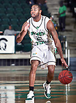 North Texas Mean Green guard Shannon Shorter (21) drives it down court in the game between the Texas State Bobcats and the University of North Texas Mean Green at the North Texas Coliseum,the Super Pit, in Denton, Texas. UNT defeated Texas State 85 to 62