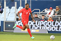 KANSAS CITY, KS - JULY 15: Cyle Larin #17 of Canada with the ball during a game between Canada and Haiti at Children's Mercy Park on July 15, 2021 in Kansas City, Kansas.