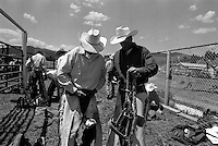 Cowboys ready their ropes before a riding competition at the annual Lincoln Rodeo in Lincoln, MT in June 2006.  The Lincoln Rodeo is an open rodeo, which means competitors need not be a member of a professional rodeo association.