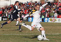 Casey Townsend #11 of the University of Maryland winds up a shot during an NCAA quarter-final match against the University of Michigan at Ludwig Field, University of Maryland, College Park, Maryland on December 4 2010.Michigan won 3-2 AET.