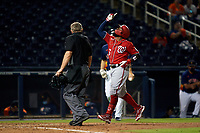 Washington Nationals Josh Harrison (5) points to the sky as he rounds the bases after hitting a home run during a Major League Spring Training game against the Houston Astros on March 19, 2021 at The Ballpark of the Palm Beaches in Palm Beach, Florida.  (Mike Janes/Four Seam Images)
