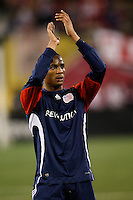 New England Revolution defender Darrius Barnes (25) salutes the Revolution fans after the game. The New York Red Bulls  and the New England Revolution played to a 1-1 tie during a Major League Soccer match at Giants Stadium in East Rutherford, NJ, on March 28, 2009. Photo by Howard C. Smith/isiphotos.com