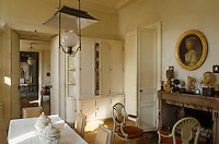 The south-facing kitchen leads into the games room, the rotunda and private lounge