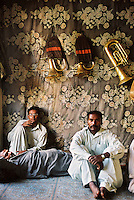 The Shiraz Brass Band relax at their office in Peshawar, North-West Frontier Province. The band members are Christians and Sikhs, which is a common profession for them in this overwhelmingly Muslim city. Many of the instruments and the uniforms worn are drawn from the traditions of British military bands, popular during the days of the Raj. They play at weddings and other functions.