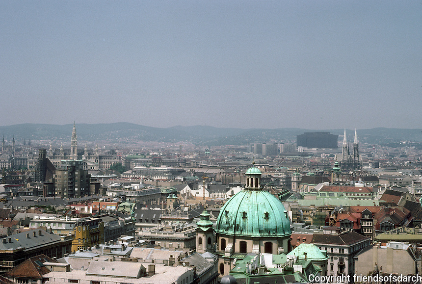 Vienna: Skyline from St. Stephen's--dome of St. Charles Borromeo; behind it to left--tower of City Hall; to right, spires of Votive Church, Neo-Gothic, 1856-1879. Photo '87.