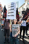 © Joel Goodman - 07973 332324 . 24/04/2011 . Brighton , UK . A protester carries a placard reading Smash Racism Smash the EDL . Nationalist street movement March for England holds a march and rally in Brighton , opposed by antifascists . Photo credit : Joel Goodman