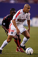 The Chicago Fire's C.J. Brown is trailed by the MetroStars' Fabian Taylor. The Chicago Fire played the NY/NJ MetroStars to a one all tie at Giant's Stadium, East Rutherford, NJ, on May 15, 2004.