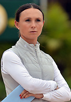 WELLINGTON, FL - APRIL 02: The Winter Equestrian Festival (WEF) is the largest, longest running hunter/jumper equestrian event in the world held at the Palm Beach International Equestrian Center. Georgina Leigh Bloomberg (born January 20, 1983) is the younger daughter of former New York City Mayor and billionaire Michael Bloomberg and Susan Brown. She is a professional equestrian, currently sponsored by Ariat International. Georgina friend hands her a ring box and a card on the course on April 2, 2016  in Wellington, Florida.<br /> <br /> <br /> People:  Georgina Bloomberg