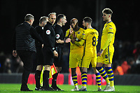 Andre Ayew of Swansea City speaks with Referee Tim Robinson at full time during the Sky Bet Championship match between Fulham and Swansea City at Craven Cottage on February 26, 2020 in London, England. (Photo by Athena Pictures/Getty Images)