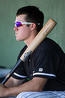 Bradley Strong (18) of the Kannapolis Intimidators watches the action from the dugout during the game against the Lakewood BlueClaws at Kannapolis Intimidators Stadium on May 8, 2016 in Kannapolis, North Carolina.  The Intimidators defeated the BlueClaws 3-2.  (Brian Westerholt/Four Seam Images)