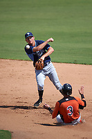 Tampa Bay Rays Michael Russell (22) throws to first as Alejandro Juvier (3) slides into second during an instructional league game against the Baltimore Orioles on September 25, 2015 at Ed Smith Stadium in Sarasota, Florida.  (Mike Janes/Four Seam Images)