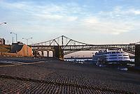 St. Louis: Levee, Eads Bridge, Veterans Bridge in background & Excursion Vessel Admiral. Photo '75.