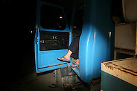 CHINA. Beijing. Mans feet hanging out of a truck. 2008