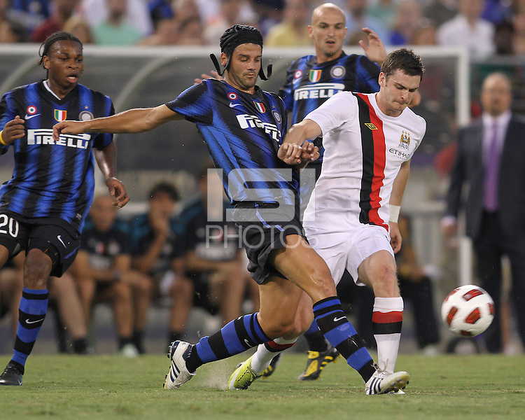 Christian Chivu #26 of Inter Milan knocks the ball away from Adam Johnson #11 of Manchester City during an international friendly match on July 31 2010 at M&T Bank Stadium in Baltimore, Maryland. Milan won 3-0.
