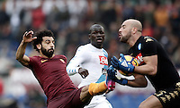 Roma's Mohamed Salah, left, is stopped by Napoli's goalkeeper Pepe Reina, right, as defender Kalidou Koulibaly, center, looks on during the Italian Serie A football match between Roma and Napoli at Rome's Olympic stadium, 4 March 2017. <br /> UPDATE IMAGES PRESS/Isabella Bonotto