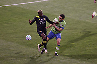 COLUMBUS, OH - DECEMBER 12: Gyasi Zardes #11 of the Columbus Crew and Shane O'Neill #27 of the Seattle Sounders FC challenge for the ball during a game between Seattle Sounders FC and Columbus Crew at MAPFRE Stadium on December 12, 2020 in Columbus, Ohio.