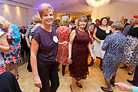 Pictured: Lottery winner Julie Amphlett (L) on the dance floor.  Wednesday 28 November 2018<br /> Re: National Lottery millionaires from south Wales and the south west of England have hosted a glitzy Rat Pack-inspired Christmas party for an older people's music group at The Bear Hotel in Cowbridge, Wales, UK.