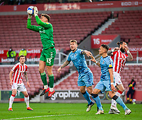 21st April 2021; Bet365 Stadium, Stoke, Staffordshire, England; English Football League Championship Football, Stoke City versus Coventry; Goalkeeper Ben Wilson of Coventry City makes a save from a high crossed ball