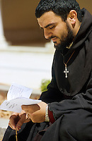 SYRIA, Melkite Greek Catholic monastery of St James the Mutilated in Qara in the diocese of Homs, praying monk  / SYRIEN Kloster in Qara in der Diozese von Homs, Melkite Greek Catholic monastery of St James the Mutilated in Qara, betender Moench