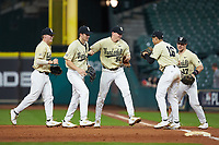JJ Bleday (51) of the Vanderbilt Commodores is greeted by teammates after a nice play on defense against the Houston Cougars during game nine of the 2018 Shriners Hospitals for Children College Classic at Minute Maid Park on March 3, 2018 in Houston, Texas. The Commodores defeated the Cougars 9-4. (Brian Westerholt/Four Seam Images)