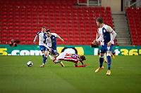 19th December 2020; Bet365 Stadium, Stoke, Staffordshire, England; English Football League Championship Football, Stoke City versus Blackburn Rovers; Powell of Stoke is brought down by Trybull of Blackburn