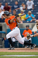 Carlos Rojas #12 of the Norfolk Tides follows through on his swing versus the Toledo Mudhens at Harbor Park June 7, 2009 in Norfolk, Virginia. (Photo by Brian Westerholt / Four Seam Images)