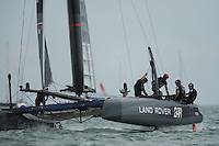 Land Rover BAR, JULY 24, 2016 - Sailing: Land Rover BAR's crew raise the dagger board during day two of the Louis Vuitton America's Cup World Series racing, Portsmouth, United Kingdom. (Photo by Rob Munro/Stewart Communications)
