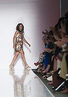 Titi Ademola, fondatrice e direttrice di KIKI Clothing, sulla passerella durante la rassegna ITC's Ethical Fashion Initiative con Altaroma a Roma, 7 Luglio 2013..<br /> Titi Ademola, founder and director of KIKI Clothing during the ITC's Ethical Fashion Initiative and  Altaroma in Rome, 7 July 2013.<br /> UPDATE IMAGES PRESS/Virginia Farneti