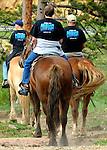 Three men riding horses at Highlands Presbyterian Camp in Allenspark, CO
