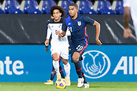 WIENER NEUSTADT, AUSTRIA - : Reggie Cannon #20 of the United States moves with the ball during a game between  at Stadion Wiener Neustadt on ,  in Wiener Neustadt, Austria.