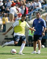 Clint Dempsey takes shots during practice as assistant coach Peter Nowak looks on. The USA defeated China, 4-1, in an international friendly at Spartan Stadium, San Jose, CA on June 2, 2007.