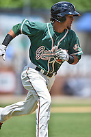 Greensboro Grasshoppers center fielder Yefri Perez #12 runs to first during a game against the  Asheville Tourists at McCormick Field June 29, 2014 in Asheville, North Carolina. The Grasshoppers defeated the Tourists 4-0. (Tony Farlow/Four Seam Images)