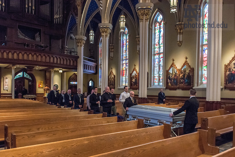 Mar. 3, 2015; Congregation of Holy Cross priests and seminarians accompany the casket of President Emeritus Rev. Theodore M. Hesburgh into the Basilica of the Sacred Heart for the visitation and wake. (Photo by Matt Cashore/University of Notre Dame)