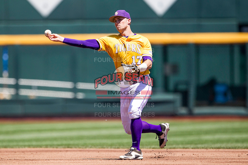 LSU Tigers second baseman Jared Foster (17) makes a throw to first base during the NCAA College baseball World Series against the Cal State Fullerton on June 16, 2015 at TD Ameritrade Park in Omaha, Nebraska. LSU defeated Fullerton 5-3. (Andrew Woolley/Four Seam Images)